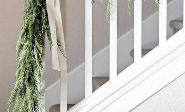 Christmas Railing Decor With Greenery Garland With White Bows