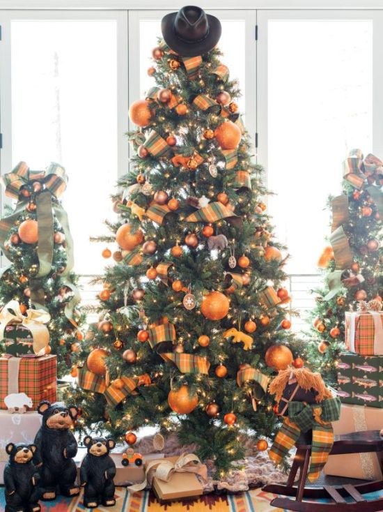 Christmas Tree Decorating Idea With Cowboy Hat Tree Topper And Bright Orange Holiday Baubles