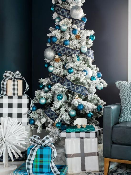 Christmas Tree Decorating Idea With Glittering Blue Ornaments In Various Sizes