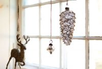 Christmas Window Decoration Ideas With Deer And Pinecone