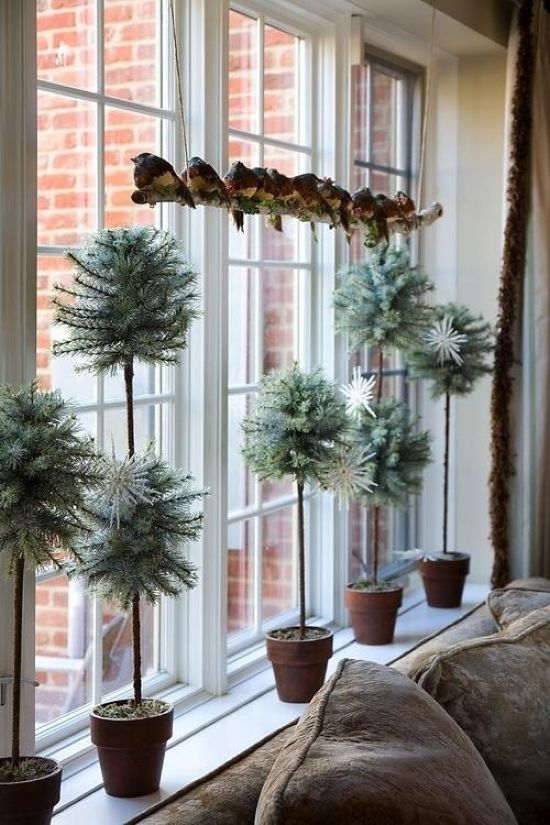 Christmas Window Decoration Ideas With Faux Tabletop Evergreens In Different Sizes