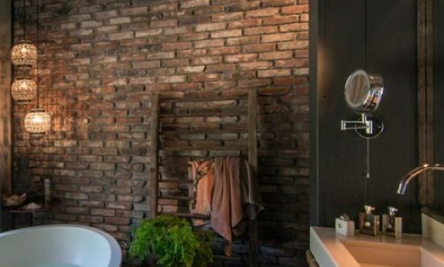Dark Bathroom With Brick Walls And Wooden Floor