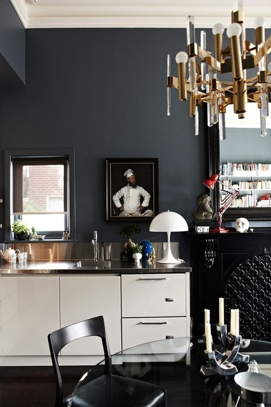 Dark Eclectic Kitchen With White Cabinets