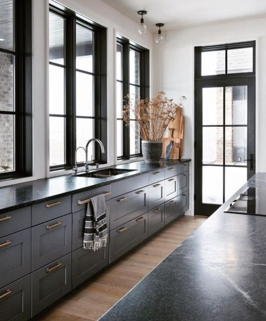 Grey Kitchen Furniture With Black Countertops And Gold Handles