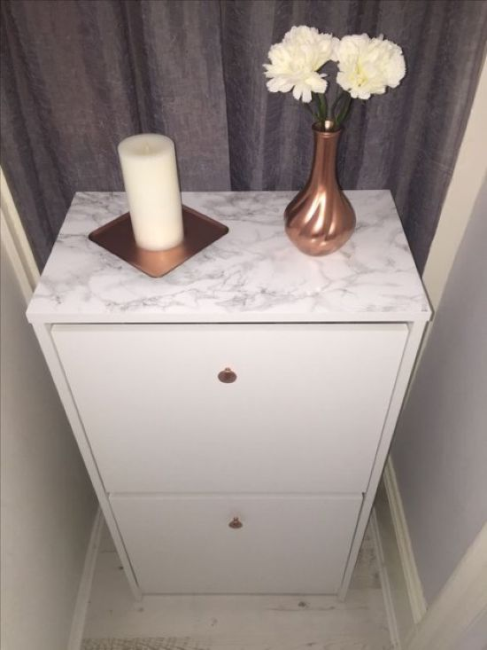 IKEA Bissa Hack Done With Copper Knobs And Marble Contact Paper