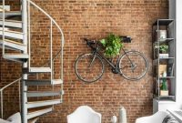 Industrial Interior Décor With An Exposed Brick Wall With A Bike Shelf