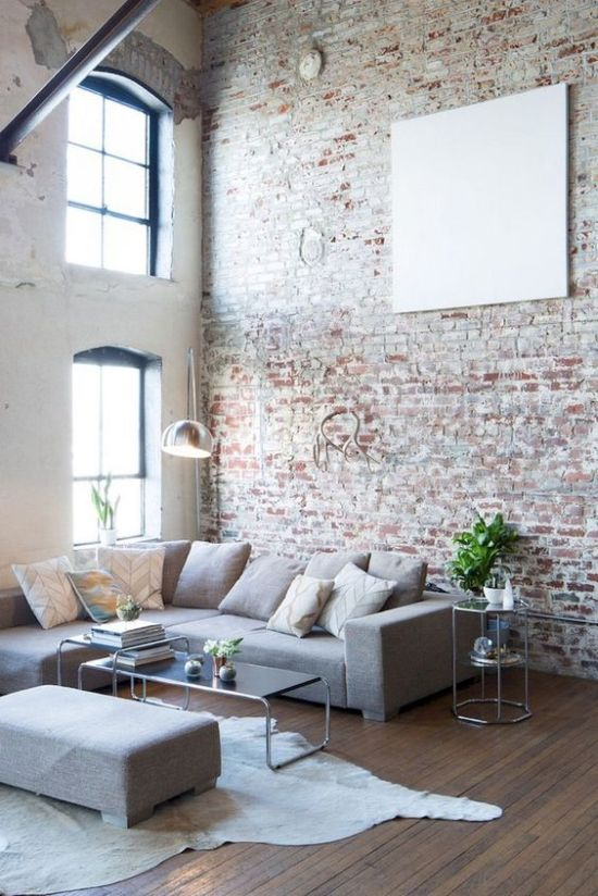 Industrial Living Room With Neutral Brick Wall And Factory-Like Windows