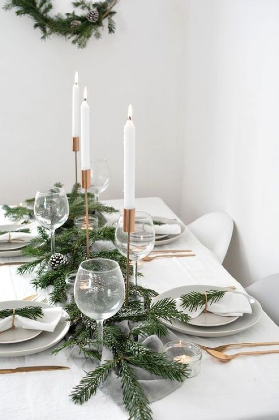Minimalist Christmas Décor With Gold Cutlery And Copper Candleholders