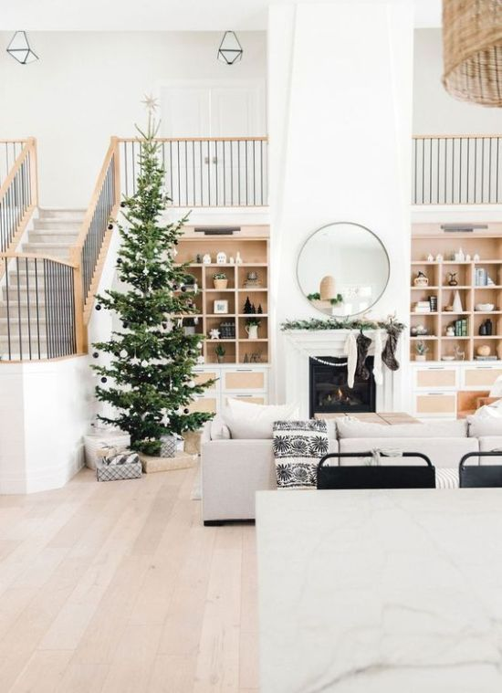 Minimalist Christmas Décor With White And Black Ornaments And Lights