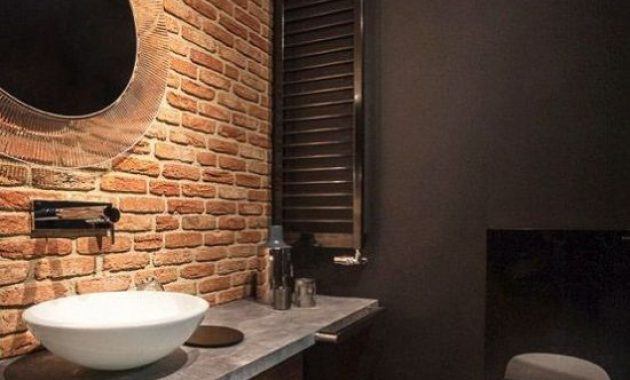 Moody Black Bathroom With Single Red Brick Wall