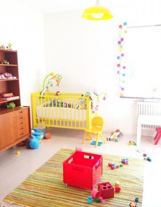 Nursery Decor Ideas With Colorful Pompom Garlands And Bright Toys