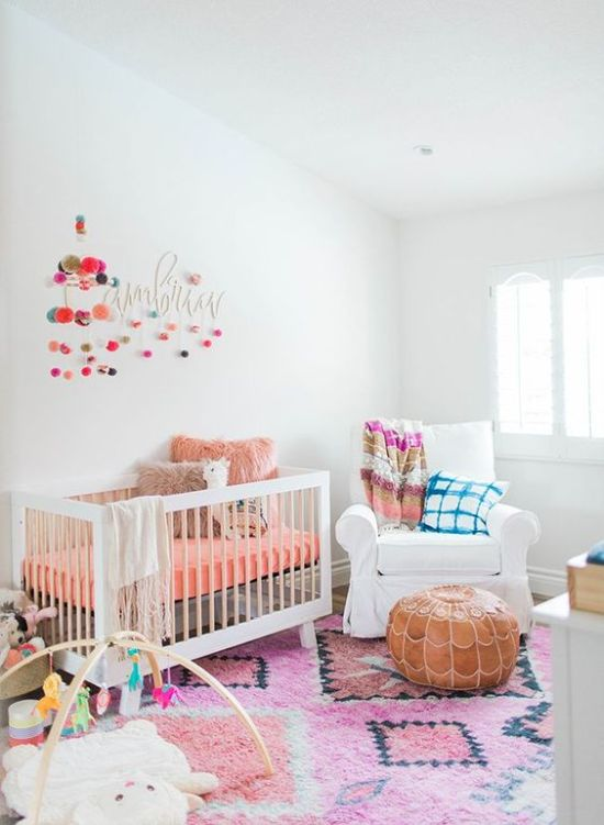Nursery Decor Ideas With Pompom Garlands And Fun And Colorful Toys