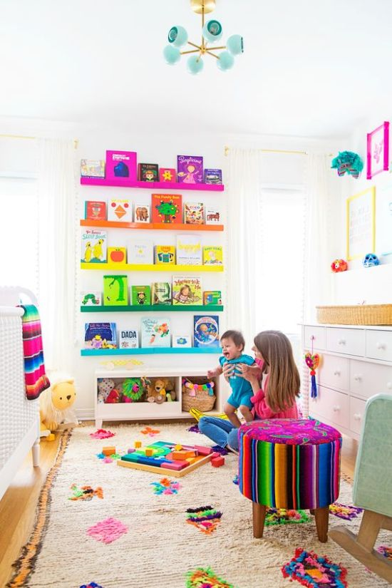 Nursery Decor Ideas With Rainbow Shelves And A Bright Rug