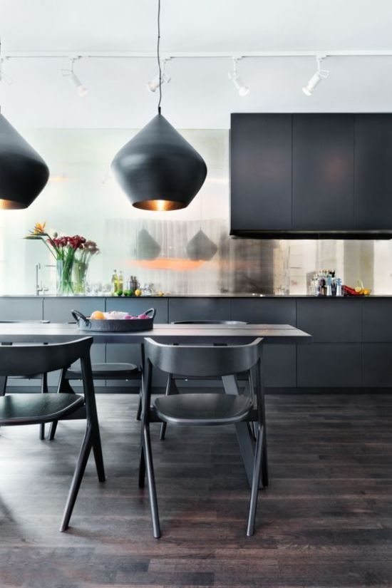Refined And Elegant Black Kitchen With A Shiny Backsplash