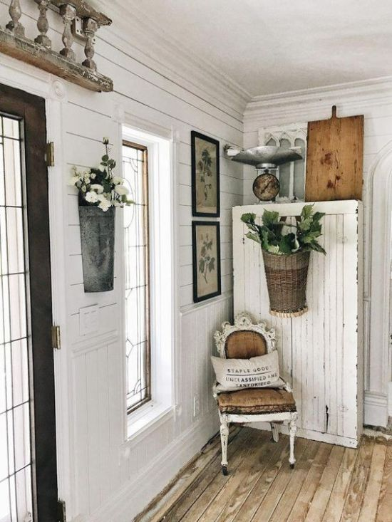 Shabby Chic Entryway With A Dresser And Potted Greenery