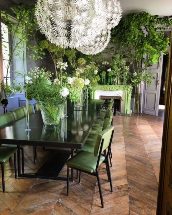 Dining Room Décor With Greenery Arrangements In Vases And Pots
