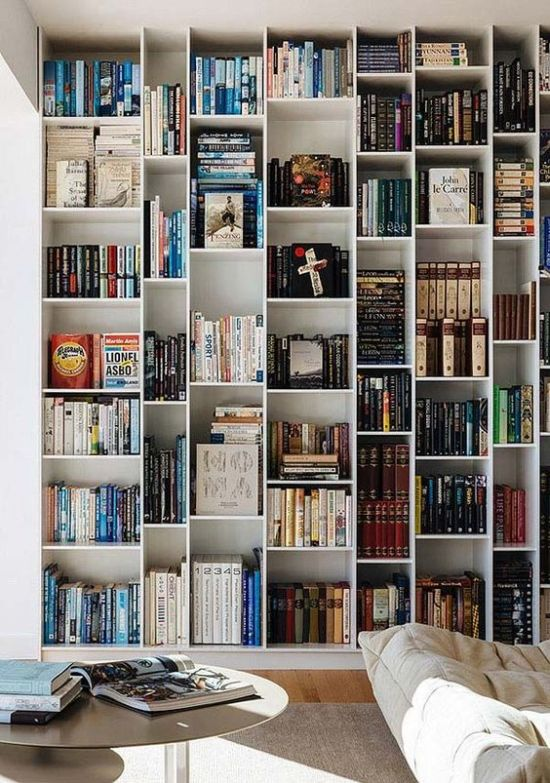 Home Library With A Large Asymmetrical Bookcase