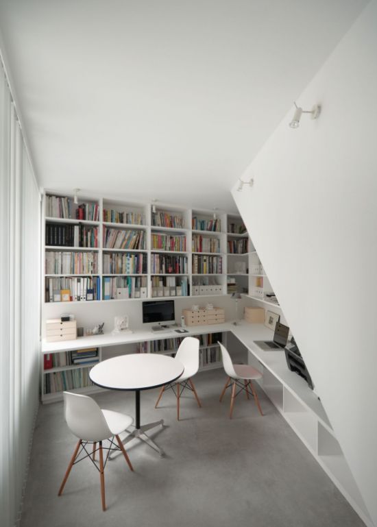 Modern Home Library With A Built-In Floating Desk And Chairs