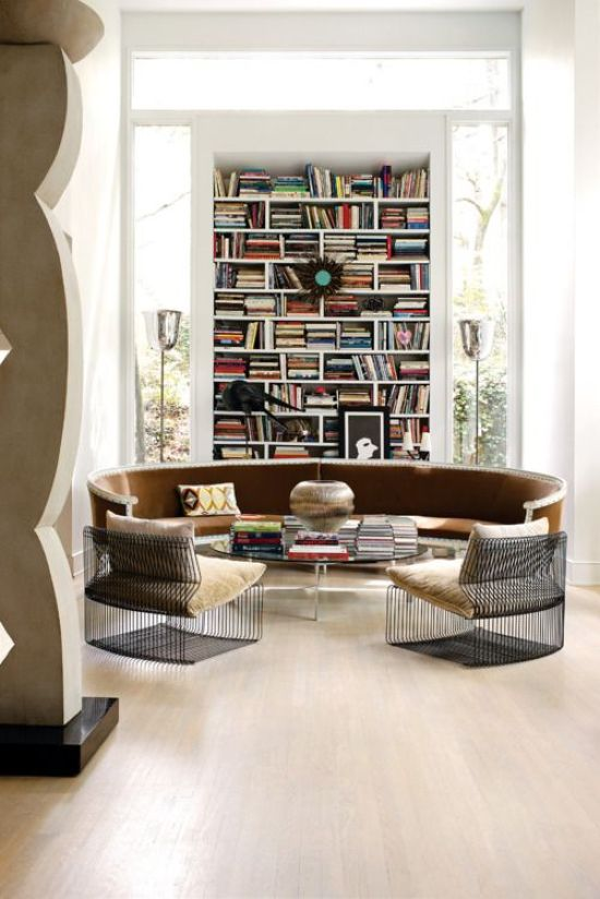 Modern Home Library With A Round Leather Seating