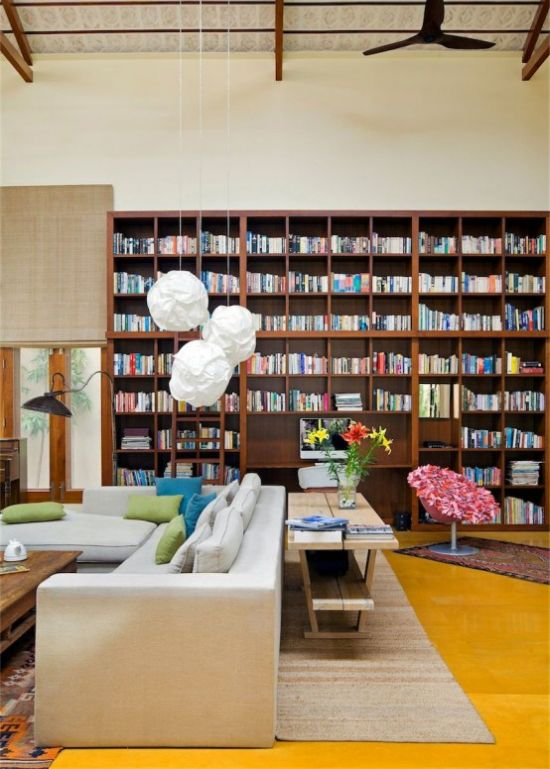 Modern Home Library With An Oversized Bookshelf Unit