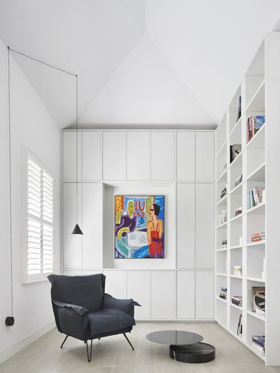 White Home Library With Built-In Bookshelves