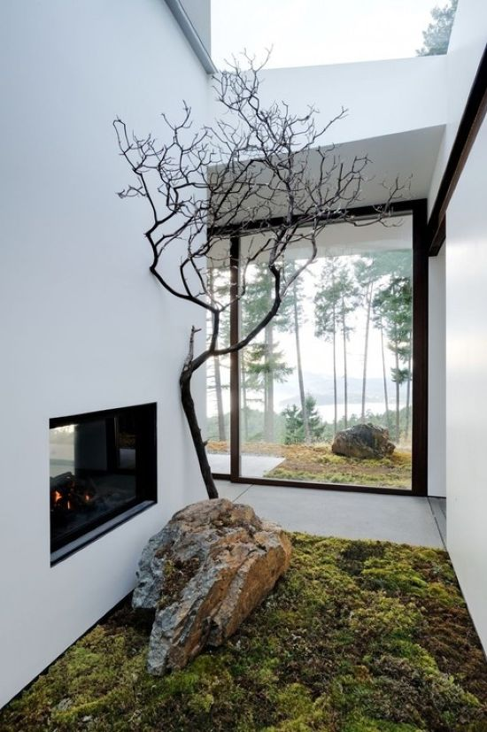 Indoor Courtyard Design Idea With A Large Rock And A Dry Branch
