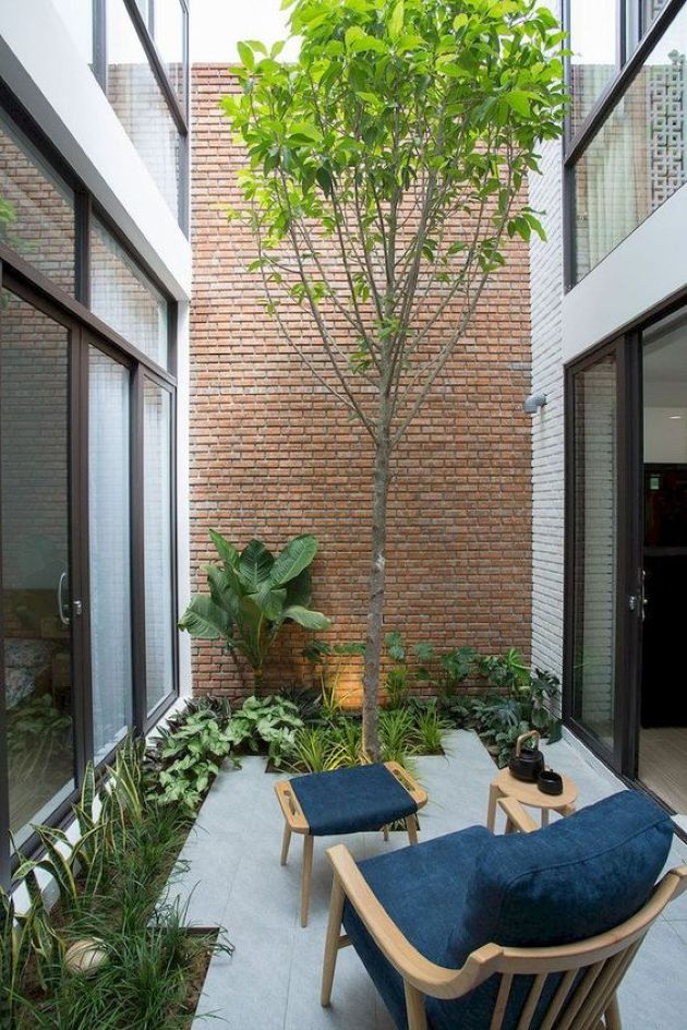 Indoor Courtyard Design Ideas With A Chair With A Footrest And A Table