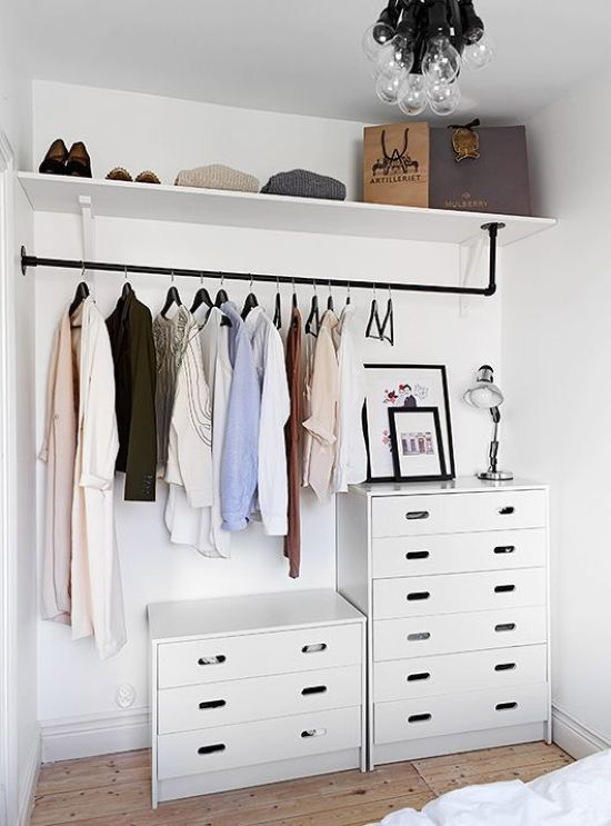 Minimalist Closet In White With An Open Shelf