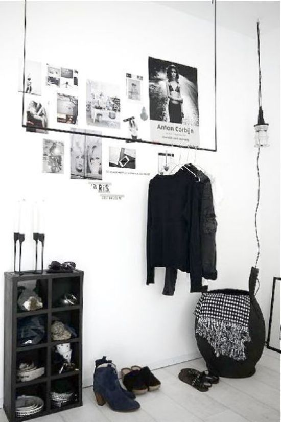 Minimalist Closet With A Black Storage Unit