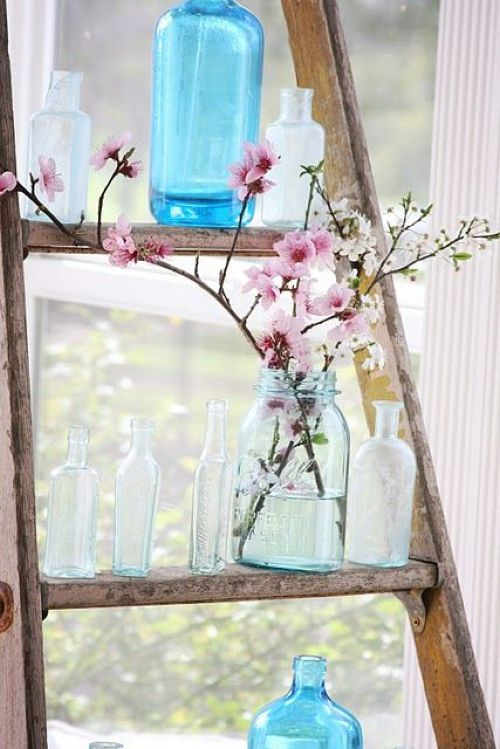 Spring Home Décor With A Blue Jar With Pink Cherry Blossom
