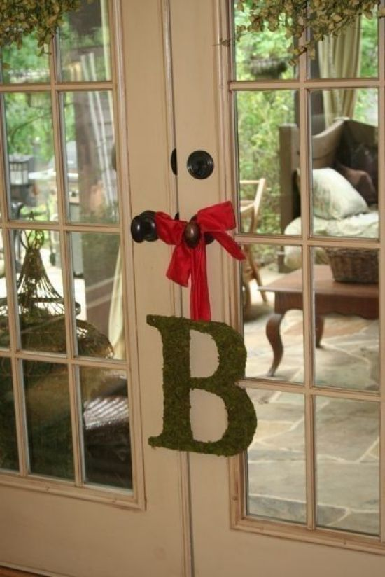 Spring Home Décor With A Moss Monogram With A Red Ribbon