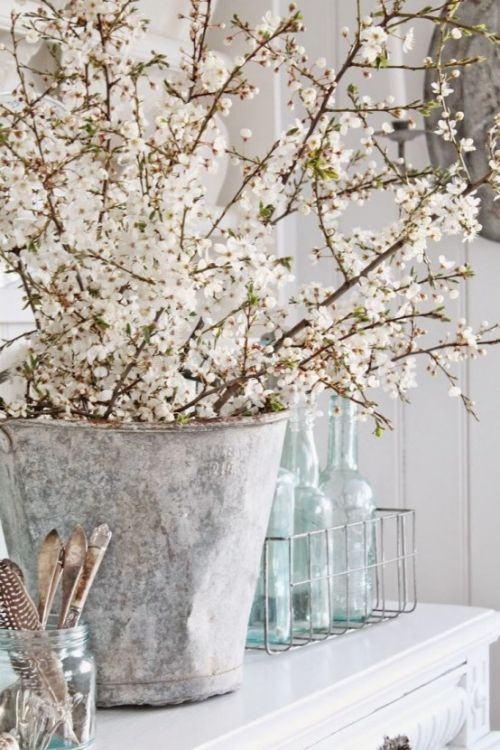 Spring Home Décor With Vintage Bucket With Lots Of Cherry Branches