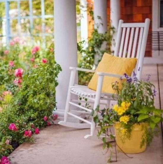 Spring Porch Decor Idea With A Pot And A Colorful Pillow