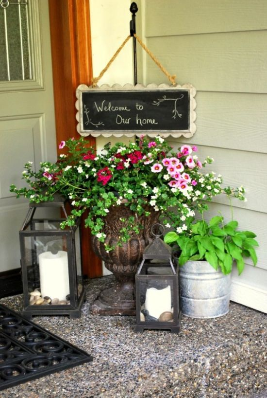 Spring Porch Decor Idea With Candle Lanterns And Chalkboard Sign
