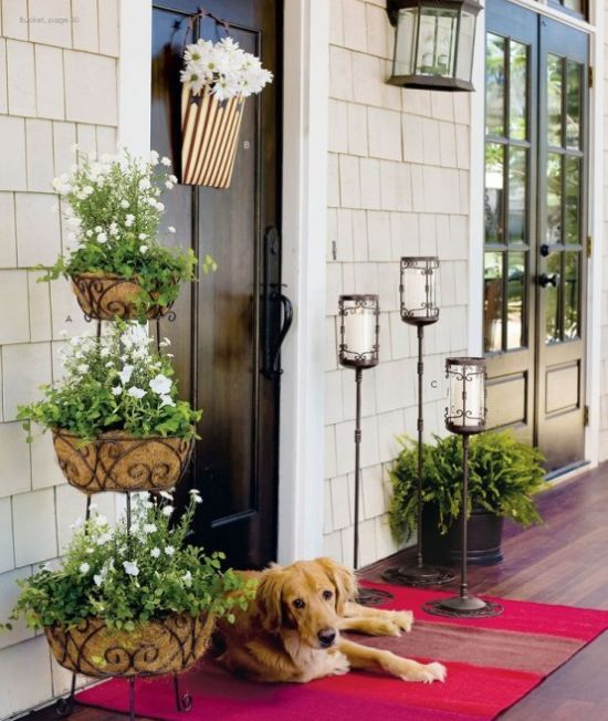 Spring Porch Decor Idea With Greenery And A Basket With White Blooms