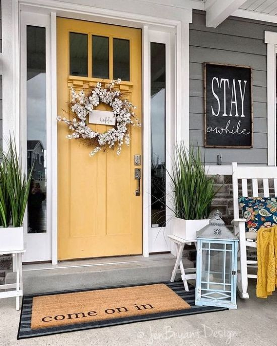 Spring Porch Decor With A Faux Bloom Wreath And A Chalkboard Sign