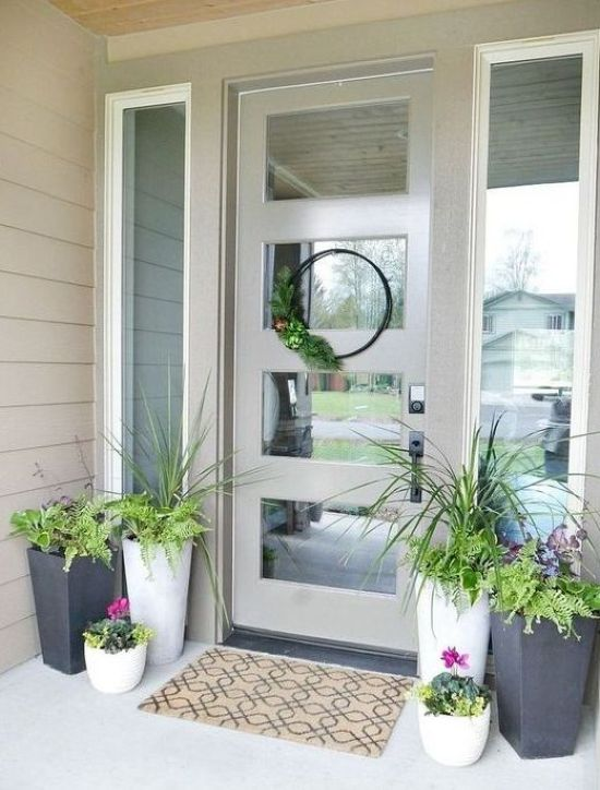Spring Porch Decor With Bright Blooms And A Greenery Wreath