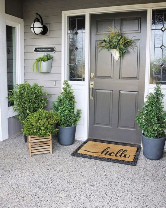 Spring Porch Decor With Greenery In Pots And Crates