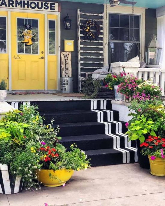 Spring Porch Decor With Potted Blooms And Greenery