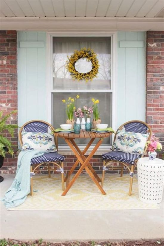 Spring Porch Decor With Potted Blooms And Tulips In Vases