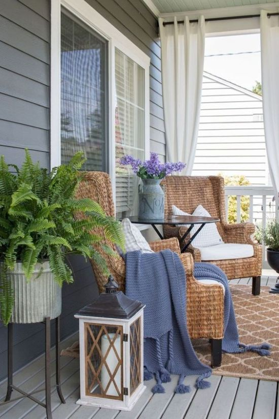 Spring Porch Decor With Purple Blooms In A Churn