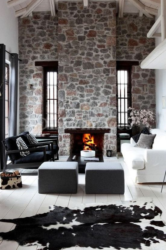 Stone Fireplace With Black And White Sofa