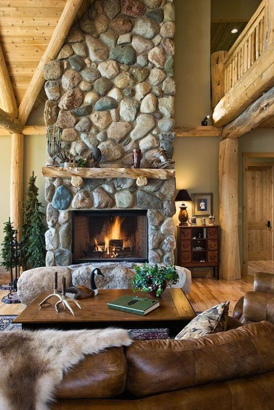 Stone Fireplace With Leather And Wood Furniture