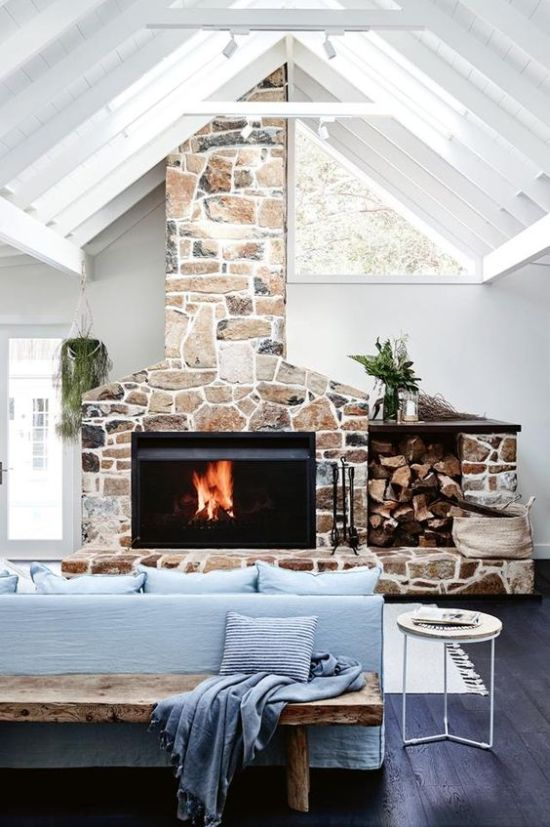Stone Fireplace With Old Wooden Chair And Greeneries