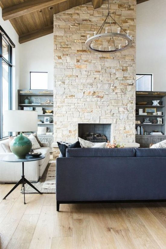 Stone Fireplace With Vintage Blue Sofa With Vintage Rug