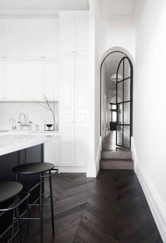 Arched Black French Door With A Black Kitchen Island