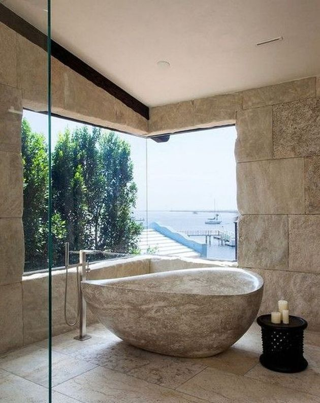 Catchy Bathroom With Stone Bathtub And Sea View