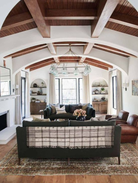 Chic Spanish Living Room With White Walls And Ceilings