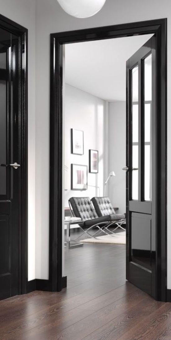 Glossy Black Doors With Black Chairs