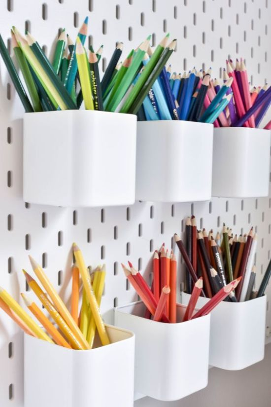 Home Office Organizing With White Pegboard With Pen Holders